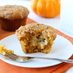 Pumpkin muffins filled with a dollop of cinnamon cream cheese.