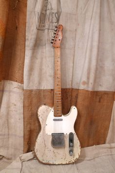 This Fender Telecaster was made in the USA in 1959. This guitar shows extremely heavy wear, and it was clearly outdoors for a considerable amount of time and the original finish is about as rough as can be, although it is still there and its not flaking off. The guitar is original except for one tuner, and it has been refretted. Also, the bridge pickup was rewound, although it is extremely difficult to tell and it looks perfect. Despite the wear the guitar plays ...