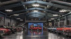 In Arcadia, a stylish garage showcases a beloved automotive collection. Arcadia Car, 1965 Shelby Cobra, Building A Garage, Dark Grey Walls, Phoenix Homes, Custom Garages, Camaro Ss, Road Bikes, Collector Cars
