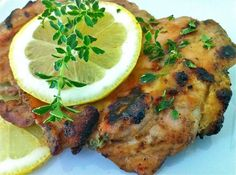 Lemon Thyme Dijon Grilled Chicken--a delicious grilled variation of the popular Wicked Good Chicken that uses just a few basic ingredients!