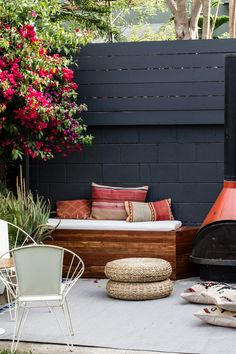 outdoor patio featuring DIY built-in benches and vintage fireplace