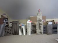 I recently was tasked with building a city skyline for a parade float. As usual, I used cardboard and duct tape as most of my materials, al. Godzilla Party, Godzilla Birthday Party, Batman Birthday, 3rd Birthday, Cardboard City, Cardboard Crafts, Gta, Superhero City, Art For Kids