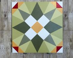 The barn quilt shown is for a 2 x 2 using primitive colors. The wood is exterior grade MDO plywood and multiple layers of exterior paint. Colors are: Black, Dark Yellow, Sage Green (looks gray in the pic), Brick Red. This size would look great on your shed, garage, or small barn! Barn quilts are made to order. Please allow 1 -2 weeks.