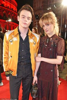 All smiles: Stranger Things stars Charlie Heaton and Natalia Dyer looked loved up as they walked the red carpet outside of the Fashion Awards 2017 in London.