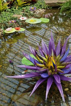 Glass waterlily flowers (garden art)