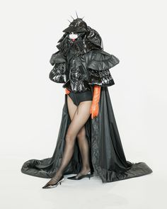 THE DOMINO CAPE, nylon cape with hoodie worn over shiny black hunchback puffer coat. Graduation collection, Broken World and the Beast, Benji Nijenhuis BA ArtEZ University of the Arts Arnhem 2020 collection Photographer - @teampeterstigter Make Up - @thecountess.official Model - @coosje_froentjes #1Granary #BenjiNijenhuis #thenightmaredisorder #ArtEZfashiondesign #50scouture #apocalyps #scifi #posthuman #thebeast Fifth Element, Fashion Figures, Fascinator, Knitwear, Sci Fi, Goth, Women Wear, African, Couture