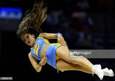 Bruins cheerleader performs during a regional semifinal of the 2014 NCAA Men's Basketball Tournament against the Florida Gators at the FedExForum on. Ucla College, College Football Schedule, Basketball Schedule, College Cheerleading, Best Basketball Shoes, Basketball Teams, College Basketball, Basketball Floor, Baseball Shoes