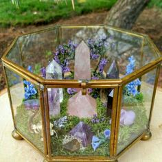 What a beautiful way to incorporate your healing crystals into your home and garden! Nature's Treasures has so many crystals that would look amazing in this terrarium!
