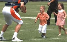 Peyton Manning greets his two young children and gets tackled by his son. (Courtesy of KDVR)