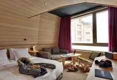 warm wood tones contrasting with the vibrant colors of the fabrics soft bedding