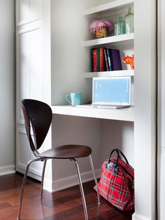 The smallest space can be turned into a work area. This unused nook has been transformed into a functional office with a few well-placed wood shelves and a sleek chair.