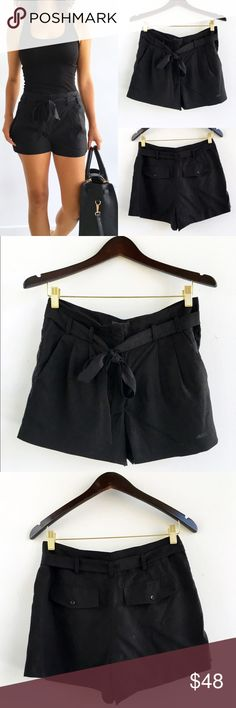 """BCBGMAXAZRIA Black Aldan Belted Shorts BCBGMAXAZRIA Black Aldan Belted Shorts. Perfect pleats, functional pockets and lightweight feel. Excellent condition. Front slash pockets, back flap pockets. Lyocell material. Lining: stretch poplin-cotton,nylon,spandex. Adjustable belted waist. Hits mid thigh. Size 2 can fit 2/4. Measurements Waist-29"""" hips-38"""" length-13.5"""" inseam-2.5"""" BCBGMaxAzria Shorts"""