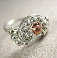 Simple but stunning. I love the contrast of the one copper toned bead.