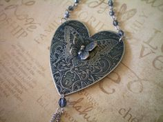 etched metal heart necklace  etched by RescuedAngelsStudio on Etsy, $36.00  Pure Sweetness and Light.