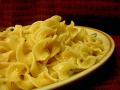 Hot Buttered Garlic Noodles from Food.com: Don't forget to boil your noodles first!  								This is a twist on classic hot buttered noodles.  These are perfect for any occassion and are super simple to make!