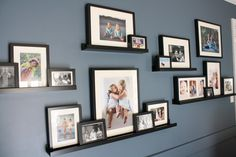 DIY Family Room Renovation and Reveal by Designer Trapped in a Lawyer's Body. DIY Family Room Renovation and Reveal Family Pictures On Wall, Family Picture Walls, Display Family Photos, Room Pictures, Shelves For Pictures, Picture Frames On Shelves, Picture Wall Shelf, Living Room Picture Ideas, Collage Picture Frames