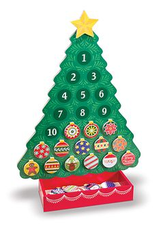 {Countdown to Christmas Wooden Advent Calendar} dd some kid-friendly holiday cheer and a charming yuletide ritual to your home with this wooden magnetic holiday tree! Look for Melissa & Doug at your local toy store!