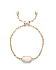 32b854ee47c6c Kendra Scott Elaina Gold Bracelet in White Opal A delicate chain bracelet  with an adjustable slide