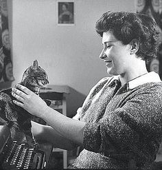 """'Black Madonna' with Doris Lessing """"If a fish is the movement of water embodied, given shape, then cat is a diagram and pattern of subtle air."""" ~ Doris Lessing, On Cats Celebrities With Cats, Celebs, Work Pictures, Inspiring Pictures, A Writer's Life, Writers And Poets, Cat People, Photos Of Women, Book Authors"""