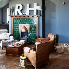 Blue living room with green fireplace | Decorating | housetohome.co.uk
