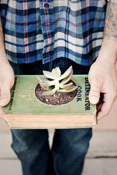 Book planter...HOW FUN!!! I'm goona have a hard time cutting a hole in a book but it is such a beautiful arrangement!