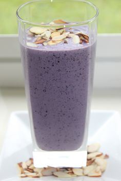 A Protein Smoothie That Helps Reduce Belly Fat ~ 1 cup almond milk plus water to desired consistency 1/2 cup frozen blueberries 1/4 frozen banana 1/2 tbsp almond butter 1 tbsp sliced almonds, toasted 1 scoop vanilla protein powder