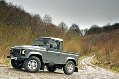 Cute as a button. LR Defender 90 Pick Up. Three seats, drab paint, white roof... even better with white alloys.