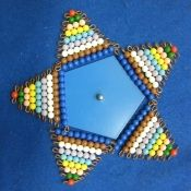 Star with pentagon inset and bead stairs