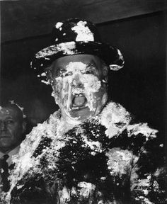 A man's face is covered in cream as a result of a pie fight in the War Room on the set of Stanley Kubrick's movie 'Dr. Strangelove, Or How I Learned to Stop Worrying and Love the Bomb', ca. 1963. Photo: Weegee(Arthur Fellig)/Internatio, Getty Images
