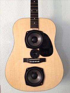 Close-up of my repurposed guitars made in to home theater speakers.