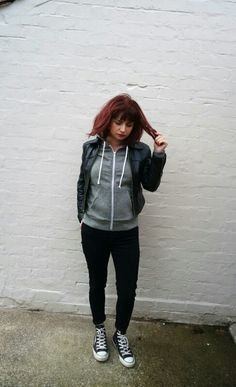 Casual grey hoodie, black leather jacket, black Levis Jeans and Converse