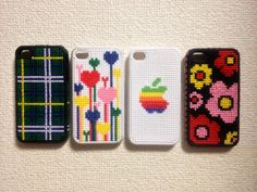 Cross stitch jackets for iPhone 4S. I made too many of them, so I can't purchase an iPhone 5 for a while. :-(