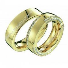 Detalhes do Produto:              Par de alianças de noivado, ouro e casamento em ouro amarelo 18k 750  Pedras: 84 diamantes 0,84 pontos na aliança feminina  Classificação: P1 - Cor j ou k  Modelo: Lojas dealianças de noivado diamantes quadradas maciças  Largura: 6,5mm x 2,9 altura  Peso Médio: 24,7grs  Acabamento:Alianças de noivado18kpolido  Detalhes: Disponi...