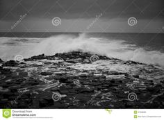 Depicts the way waves hit the hexagonal rocks and how the water fills every crack and pathway it can find