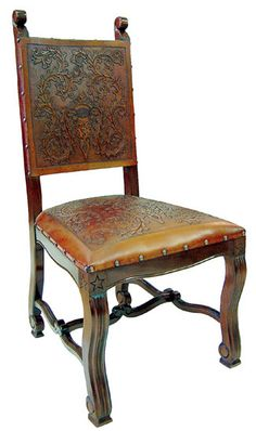 Chairs have an antique brown finish and tooled leather colonial pattern.
