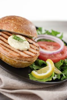 Try this Grilled Salmon Burger with Sour Cream Dill Sauce from our friends at Daisy Brand!