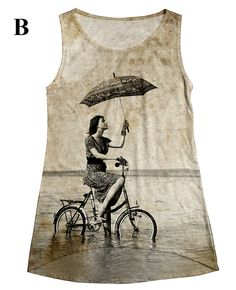 riding bicycle woman with umbrella at beach  print  top, t shirt and tank  xs - plus size