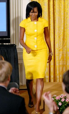 The First Lady had a spring in her step in this cheery yellow suit as she hosted a luncheon to honor The National Design Award recipients in the East Room of the White House on July 24.