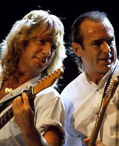 Status quo  rick parfitt and frances rossi :) seen em to many times but still enjoy em :) x
