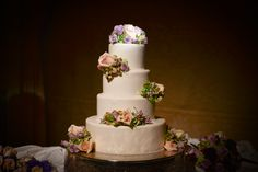 white wedding cake decorated with pastel flowers