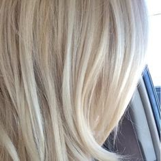 My gorgeous blonde hair that Luis color corrected from brassy blonde to a creamy blonde. I love it! Never going anyplace else! - Yelp