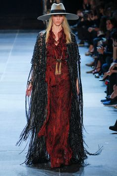 Ok- the model may be wrong choice here, but look at that handmade cape with fringe- fabulous!