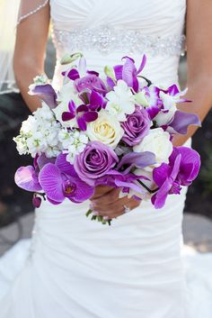 My beautiful purple and white bouquet was created by my amazing aunt who surprizinly doesn't do this as a profession! It consisted of white and purple orchids and white and purple roses. I couldn't have asked for something more beautiful.