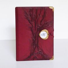 genuine leather bound with tree of life in front, and a bronze monogrammed closed by a magnet. Leather Gifts, Leather Books, Handmade Leather, Leather Jewelry, Handmade Notebook, Handmade Books, Leather Bound Journal, Custom Leather, Life Planner
