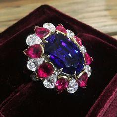 @theodoros_jeweler . #tanzanite #tripleAstone love the purplish blue set in rubies #pigeonbloodruby and pear shaped #diamonds