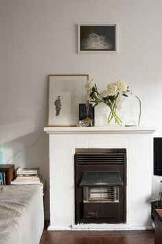 I would like to install a wall heater unit in my bathroom and build a brick surround faux fireplace like this to replace our current portable heater.   |Source|