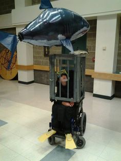Diver in a shark cage.
