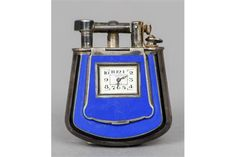 A Dunhill silver and blue enamel combination lighter timepiece (Dunhill Fancy with Watch), hallmarked 925 and with London import mark for 1927, maker's mark of Alfred Dunhill & Sons Also inscribed Dunhill, London. 5 cm high. Sold 9000€ all included, 15/09/2015.
