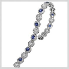 """Your """"something blue!"""" Endless Love bracelet featuring round brilliant cut bezel set diamonds and bezel set round blue sapphires that are surrounded by micropavé diamonds."""