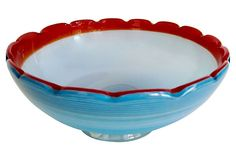 Murano bowl in cerulean blue with a red scalloped rim and white interior with white lines around the exterior of the bowl.